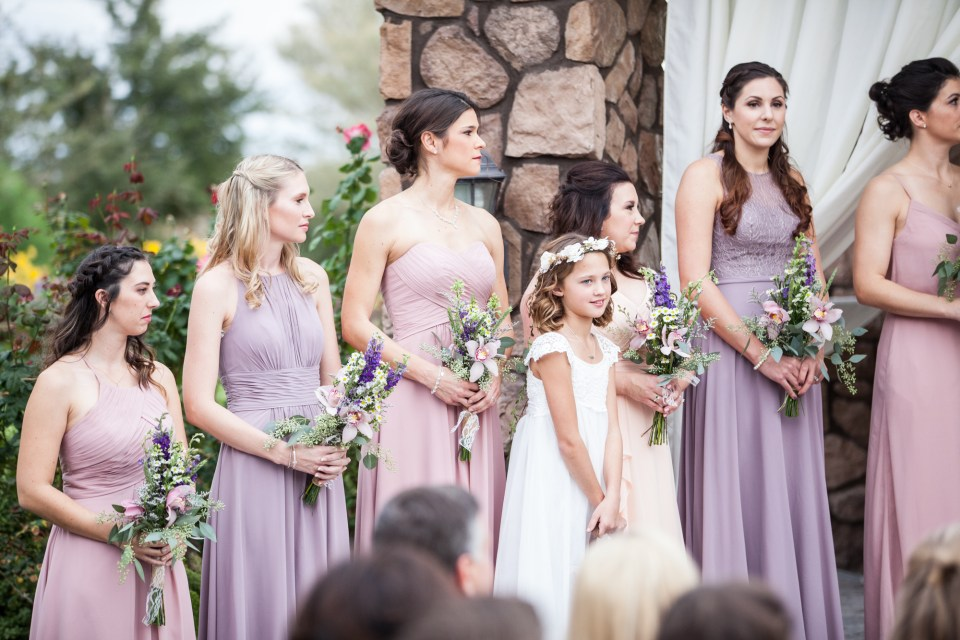 bridesmaids and flower girl during wedding ceremony