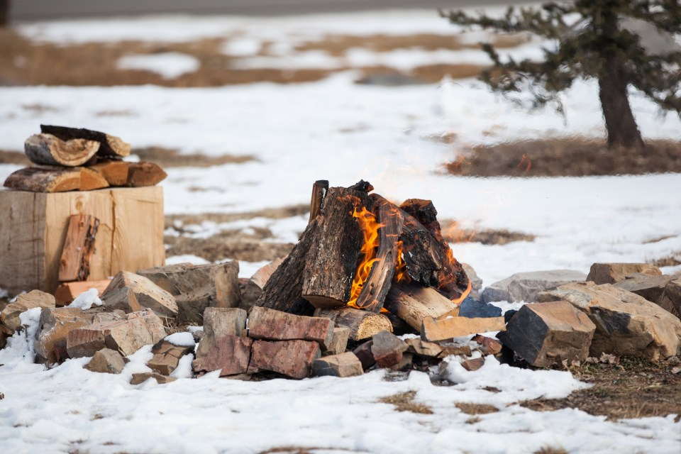 Durango, Colorado Winter outdoor wedding ideas with fire pit as backdrop