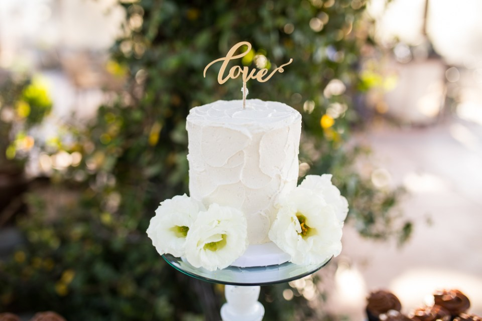Temecula Winery Wedding cake table and wedding cake with love cake topper