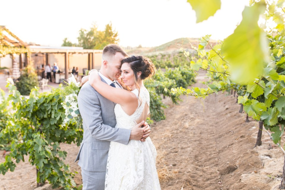 Temecula Winery Wedding bride and groom in vineyard