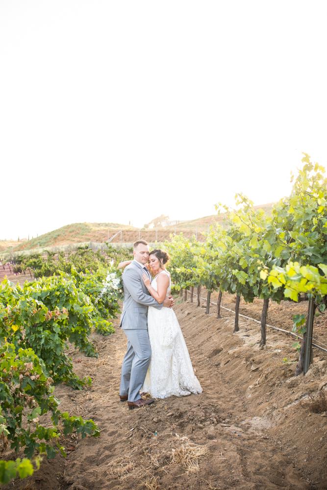 Temecula Winery Wedding bride and groom in Europa Village vineyard