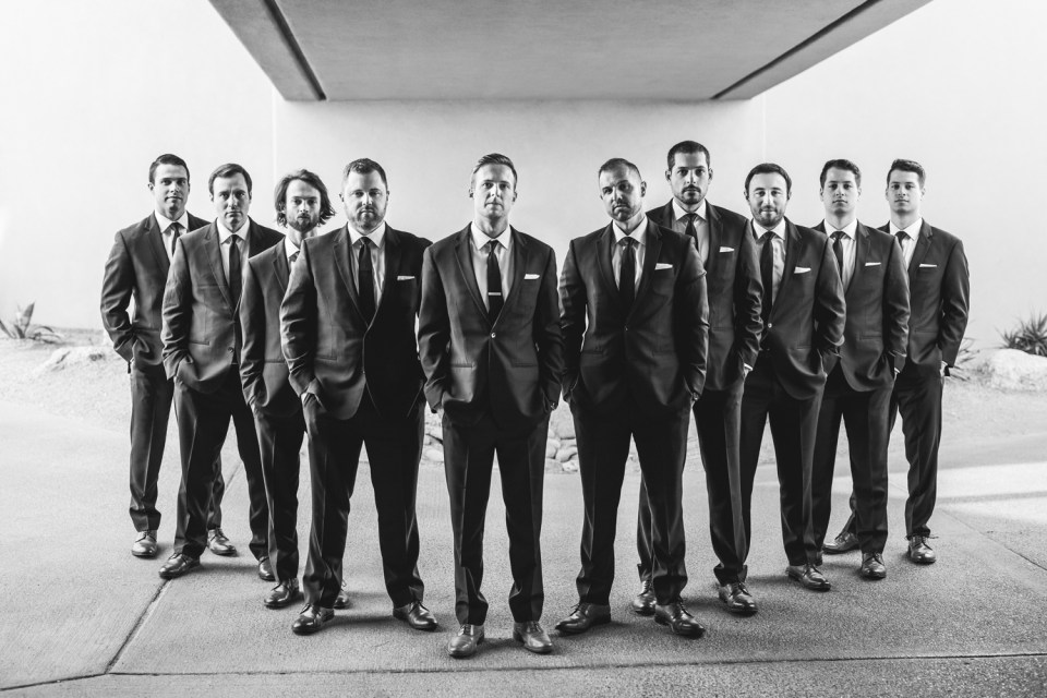 groom and groomsmen black and white photo