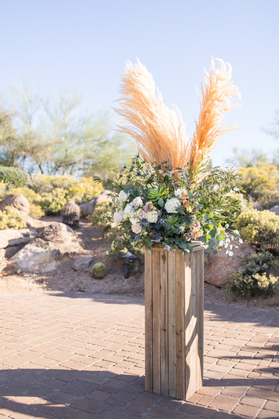 chasing bliss designs wedding ceremony floral arrangement