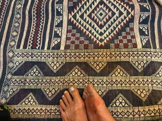 Putting my grimy feet all over these nice rugs
