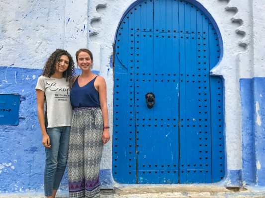 Me and Hind in front of Chefchaouen's Blue Door in 2017