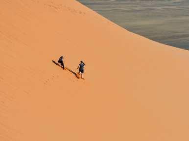 Di & Grace falling down the dune