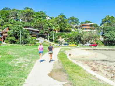Diana and Maddy walking around Sandy Bay