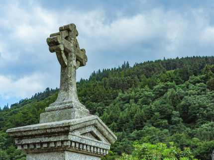 Celtic cross atop a large headstone