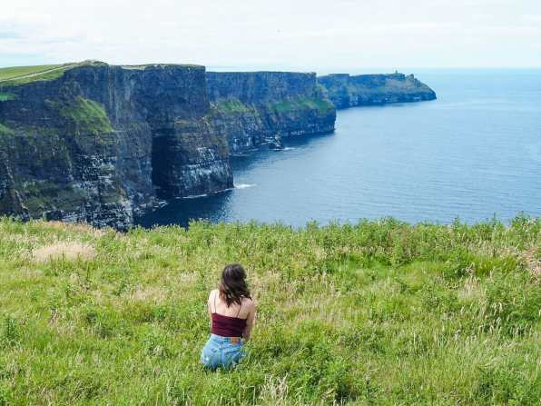 Admiring the Cliffs of Moher from a little meadow
