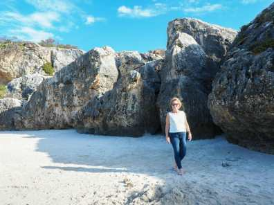 Mum strolling along the beach at Stokes Bay