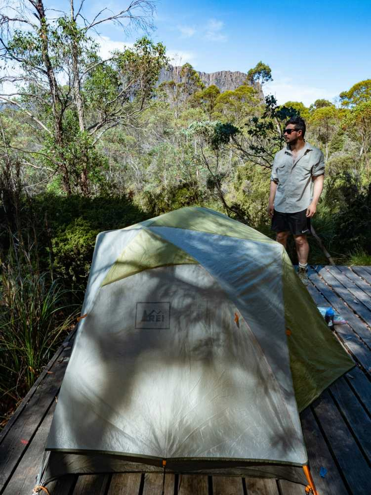 Cal setting our tent up at Kia Ora