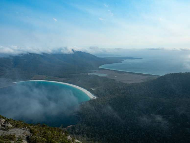 A barely visible Wineglass Bay below