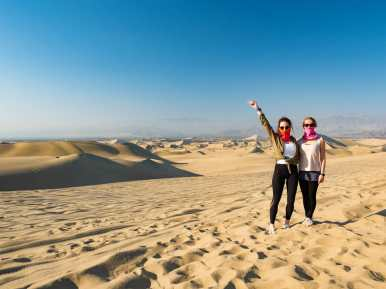 Me and Inka in the sand dunes around Huacachina