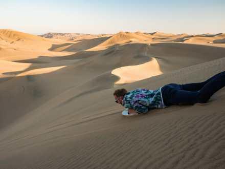 AJ sliding down the dune