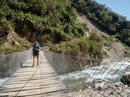 Eileen crossing a swing bridge