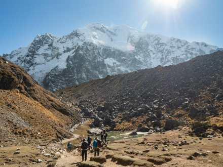 A long trail of people leading up to Salkantay Pass