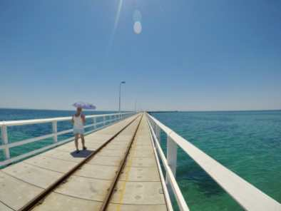 Woman walking on Busselton Jetty Western Australia