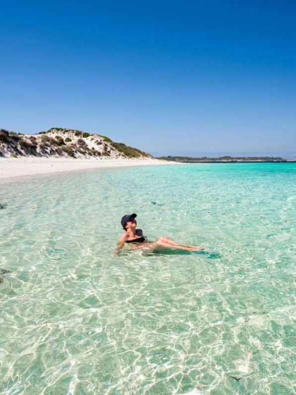 Girl on beach Rottnest Island Perth Western Australia