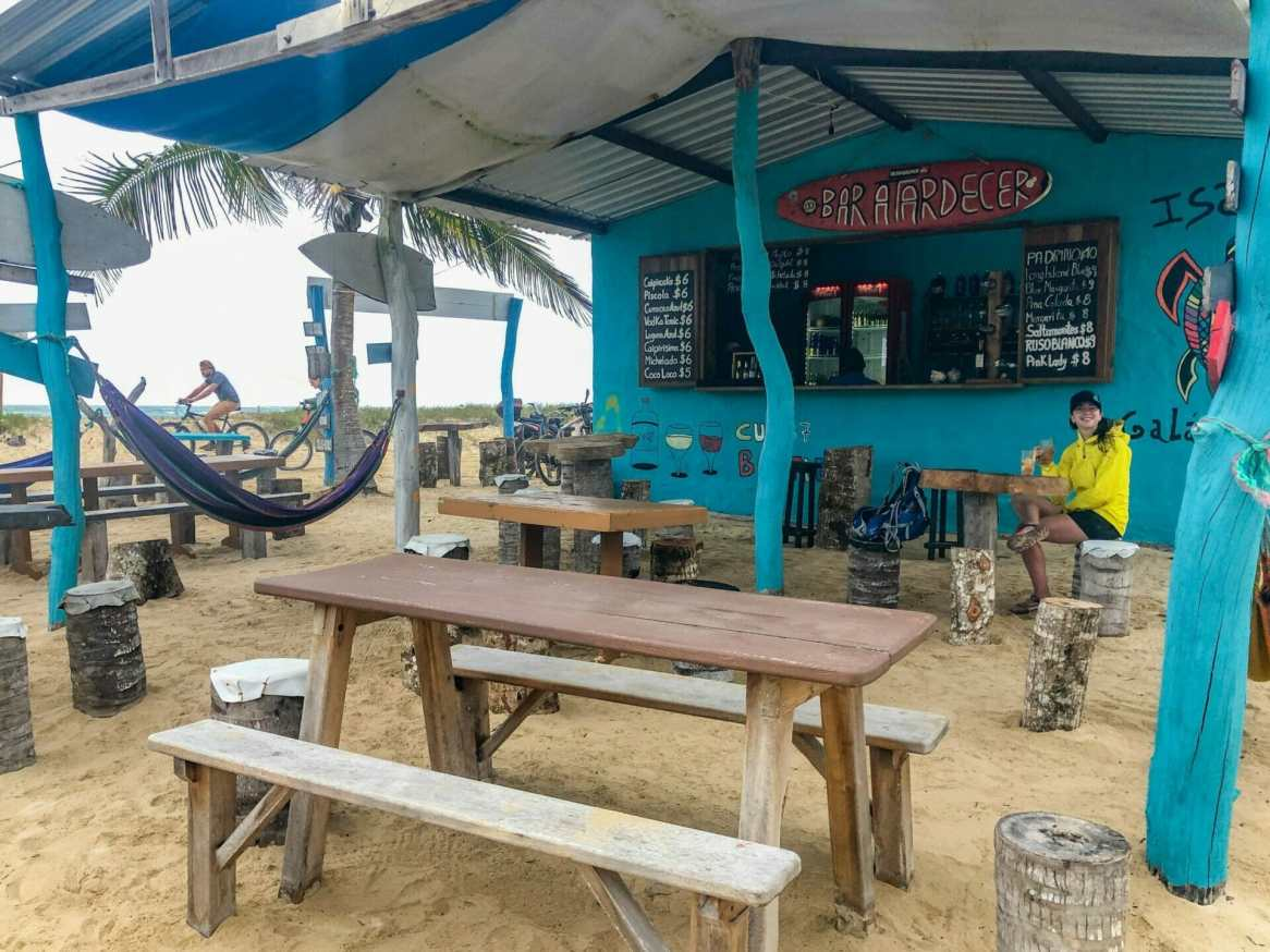 Girl sitting at outdoor beach bar Isla Isabela