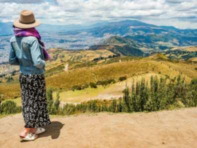 Girl standing on Pichincha Volcano overlooking Quito