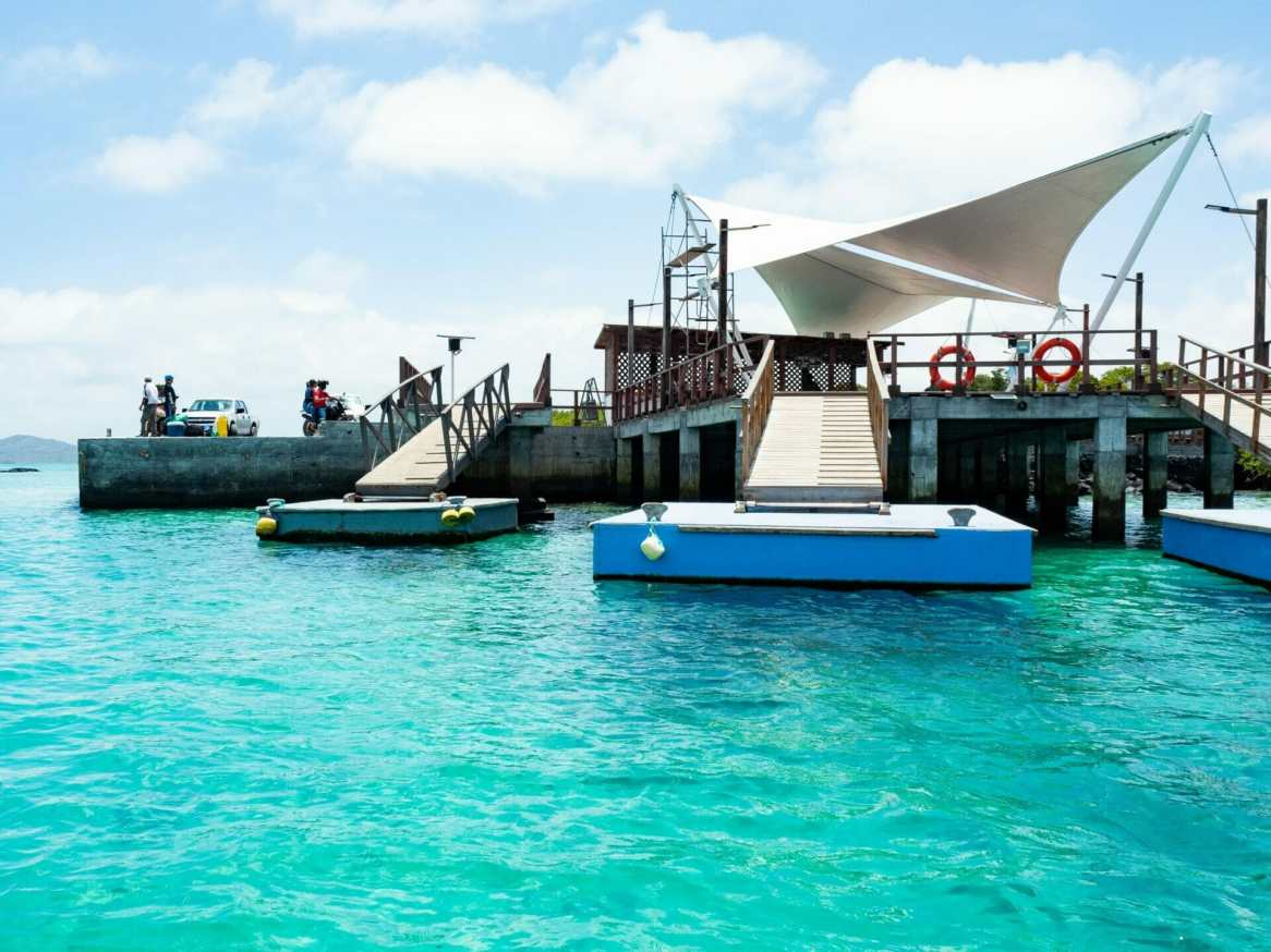 Clear blue water at ferry port in Puerto Villamil