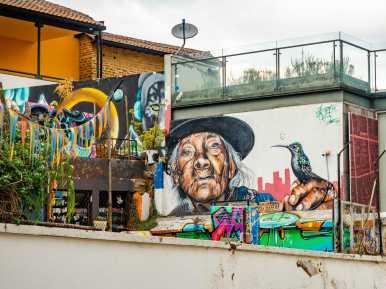 Street art mural of Indigenous woman in Quito Ecuador