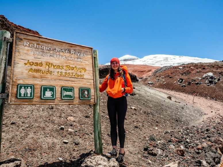 Hiker standing at Refugio Jose Rivas sign on Cotopaxi