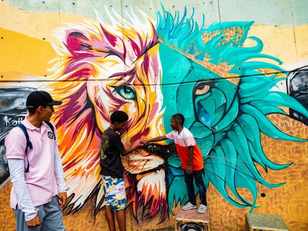 Children pointing to street art Comuna 13 Medellín Colombia