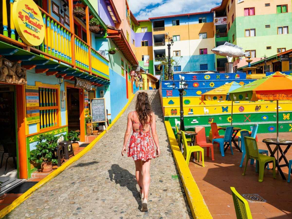 Girl walking Plazoleta de Los Zócalos Guatapé Colombia