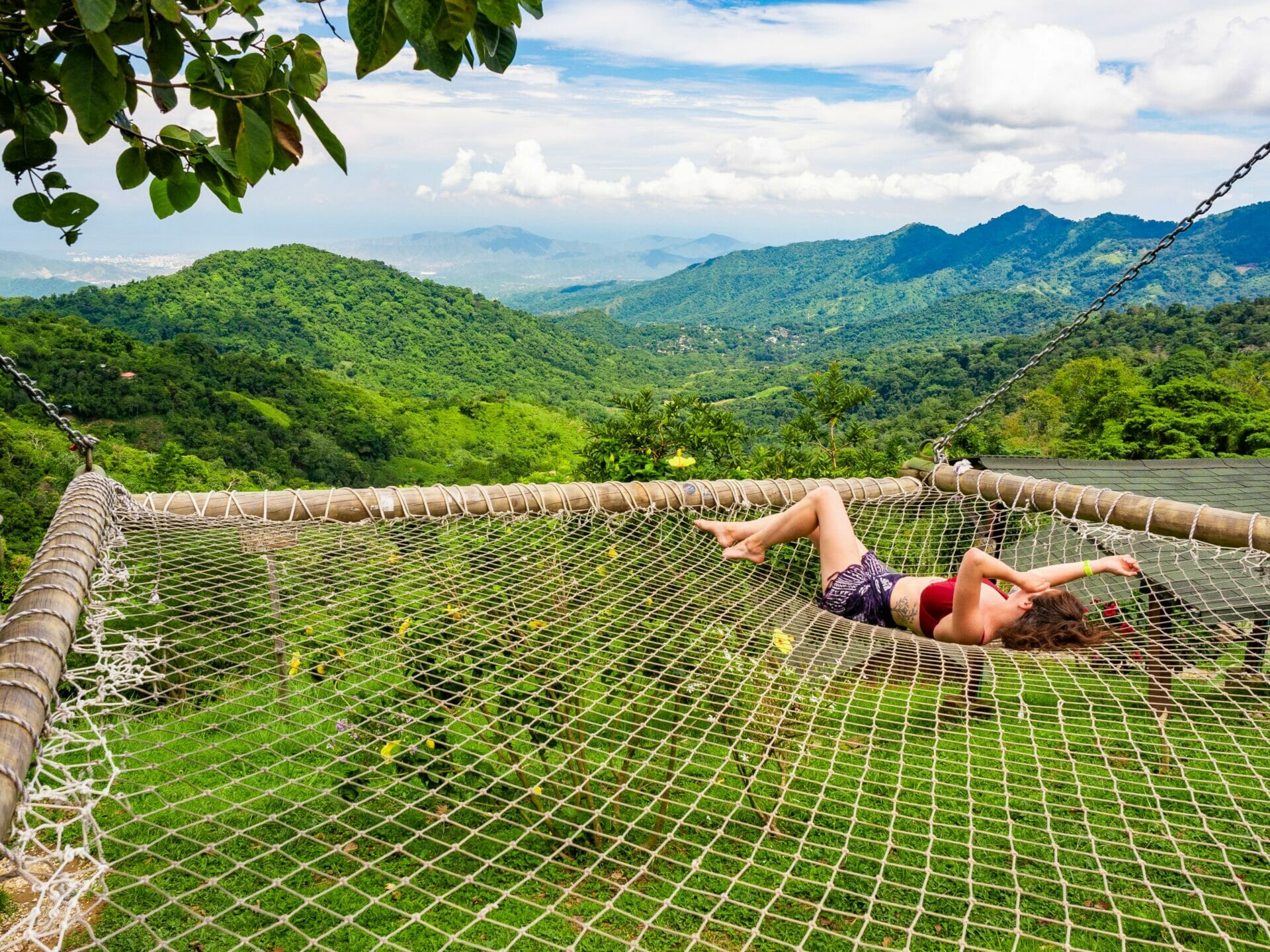 Girl laying in giant hammock Minca Casa Elemento Colombia