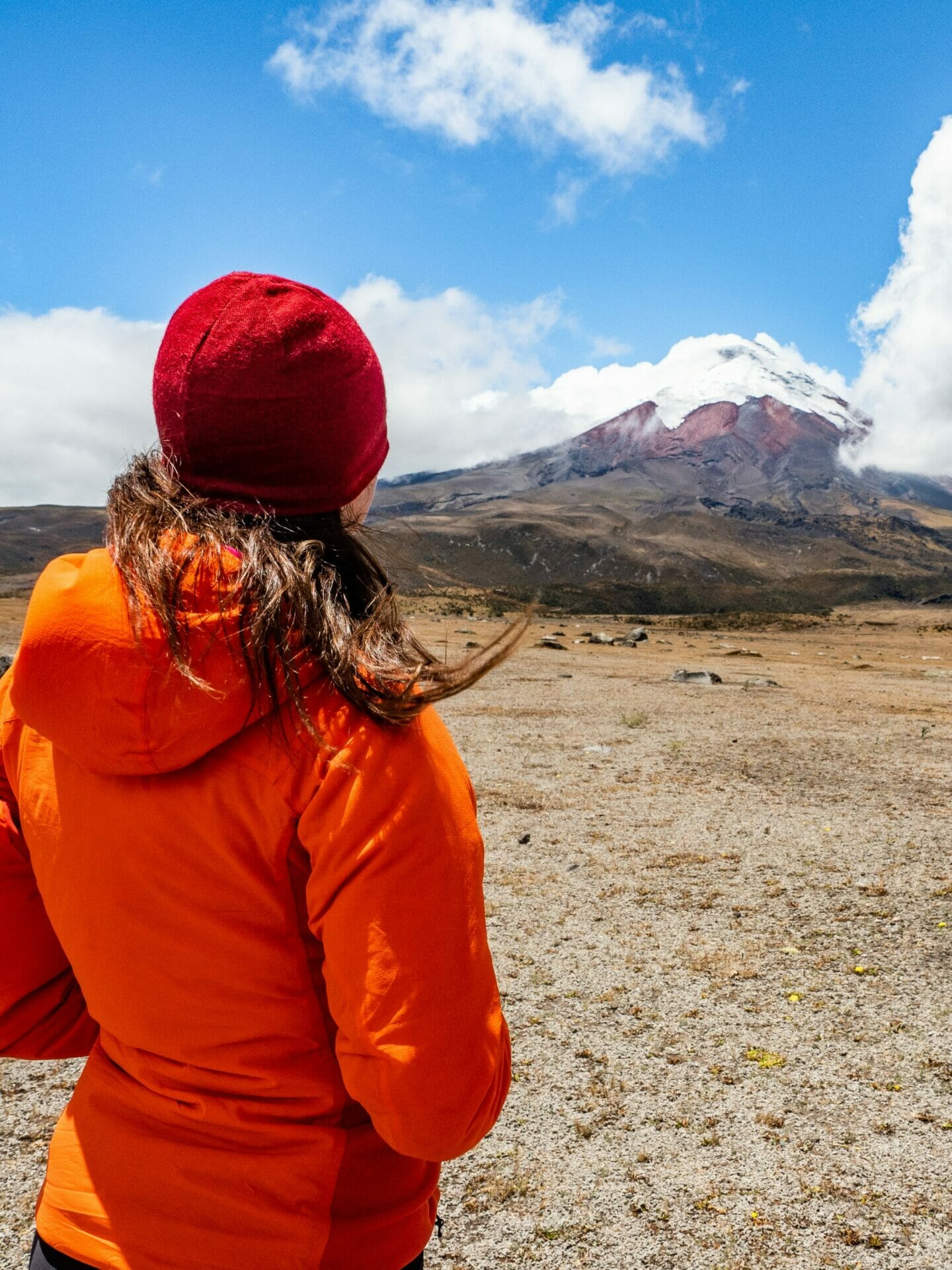 Girl looking at snowy Cotopaxi Volcano Ecuador