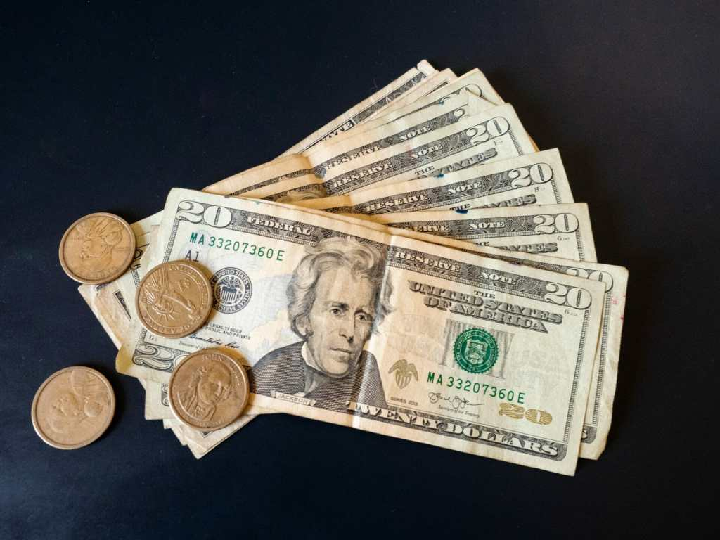 US dollar bills and coins used as official currency in Ecuador