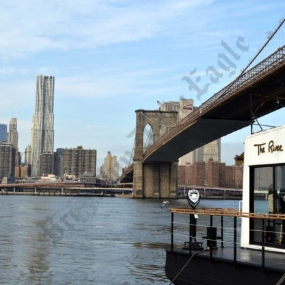 The River Cafe is located on a barge that sits on the Hudson River in Brooklyn Bridge Park. - Brooklyn Archive