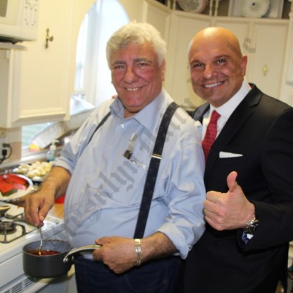 Hon. Frank Seddio (left) gets a visit in the kitchen from Arthur Aidala, the immediate past president of the Brooklyn Bar Association, during his annual St. Joseph's feast. - Brooklyn Archive