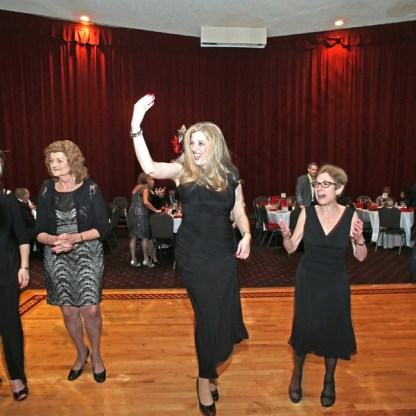Honoree Susan Master dancing. - Brooklyn Archive