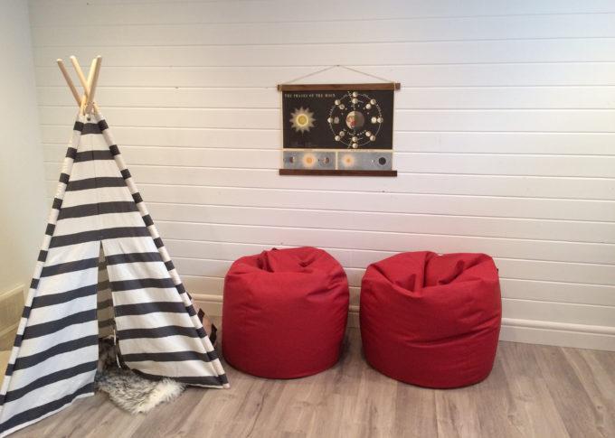 Basement playroom with shiplap walls.