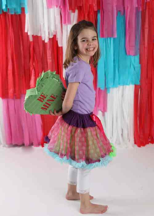 Plastic strip photo background with Conversation Heart Pinata as a prop