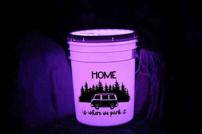 Make your own camping bucket light to welcome guests to your campsite.  Full instructions and free camping svg file included!