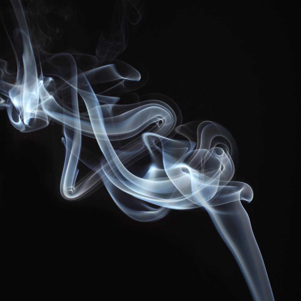 A picture of incense smoke on a black background
