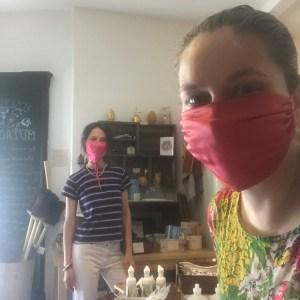 Jen and Emma wear silk masks 6 feet apart