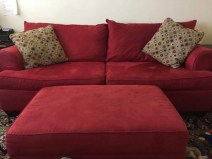 RED corduroy COUCH IN TRUCK