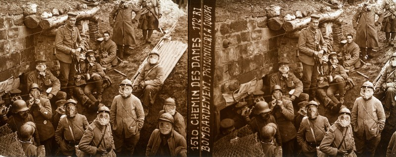 """Soldiers in a trench prepared for a gas attack, as Wilfred Owen would come to be - imagery such as this pops up in many of his poems, most notably in """"Dulce et Decorum Est"""". Gas warfare was an everyday hazard during the Great War. Courtesy of the Boyd/Jordan Collection."""
