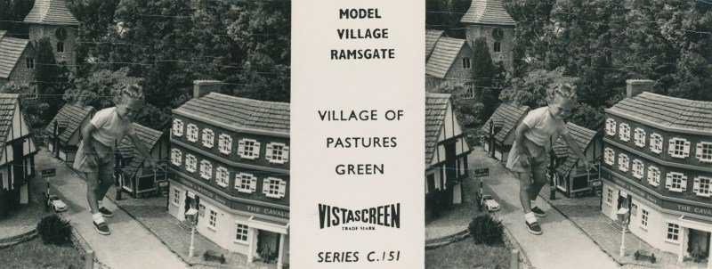 A view featuring a child playing in a model village.