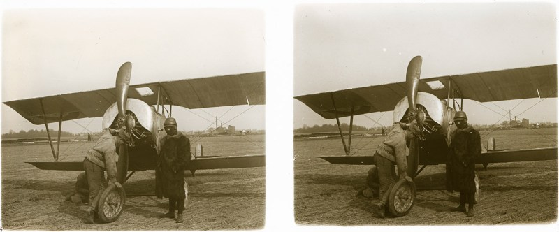 A sepia-tinted positive print of two men working on a Nieuport 10, with someone (possibly the pilot) standing by.