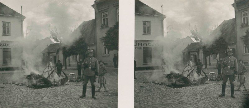 The German Invasion of Poland: The 80th Anniversary of WW2 - An image depicting a proud German soldier standing guard over a pile of burning beds.