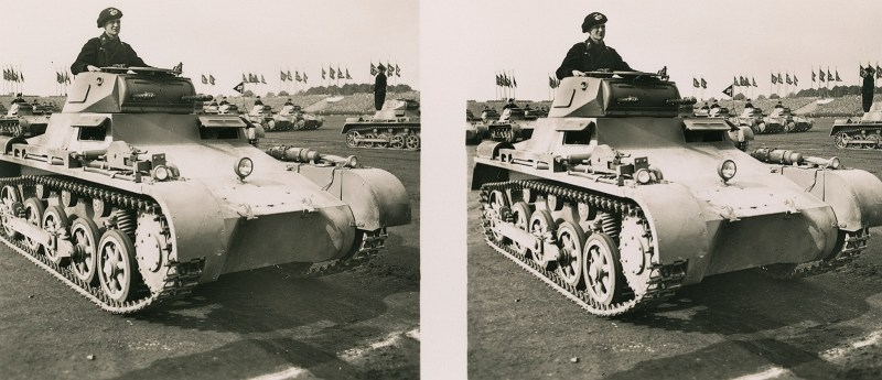 A parade of tanks, with one of them dominating the field of view. N.B. Brooklyn Stereography does not condone Nazism in any form.