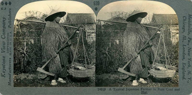A Typical Japanese Farmer in Rain Coat and Hat