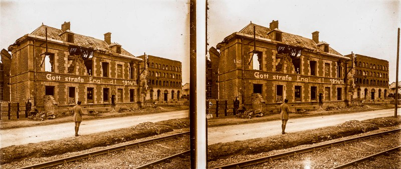 "European amateur glass stereoview depicting the notable ""Gott strafe England! 1914/15"" building in Bucy-le-Long"