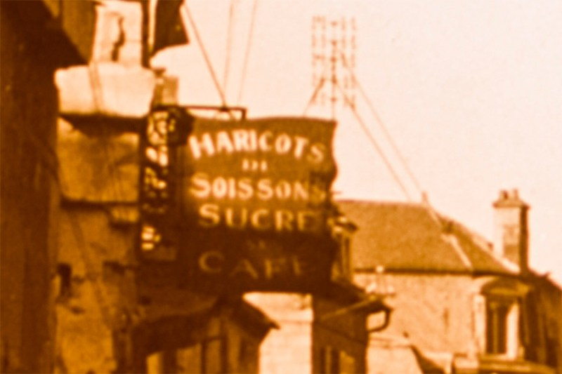 Detail from an amateur glass stereoview from Soissons, focused on a cafe sign
