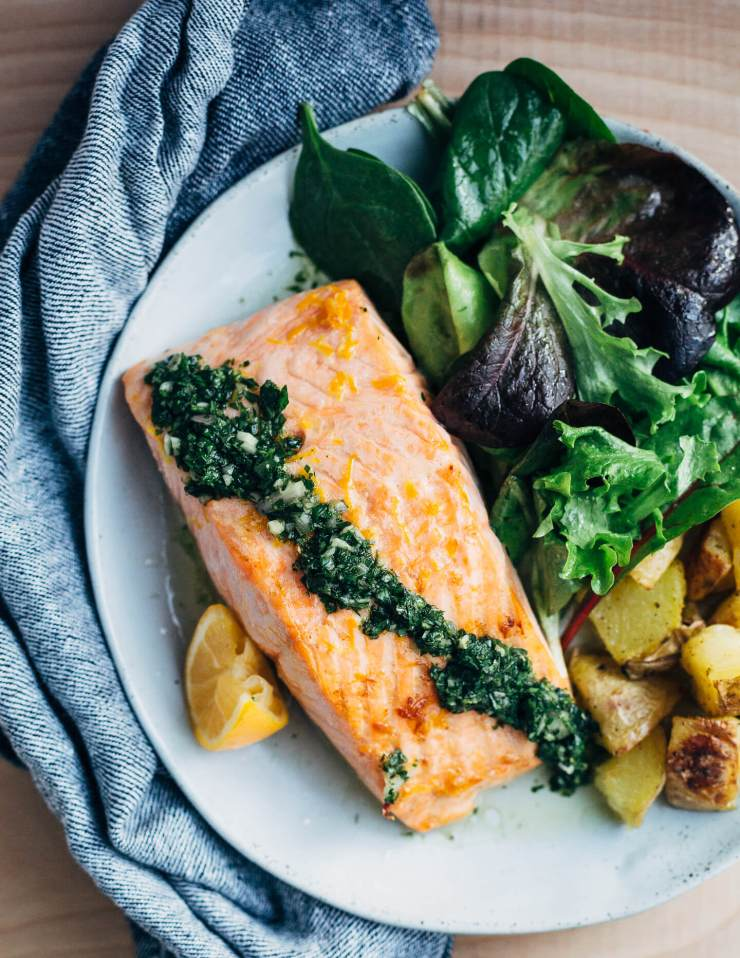 Broiled salmon fillets with a vibrant Meyer lemon and mint chimichurri makes for a simple, yet elevated mid-winter meal that's perfect for a Valentine's dinner at home.